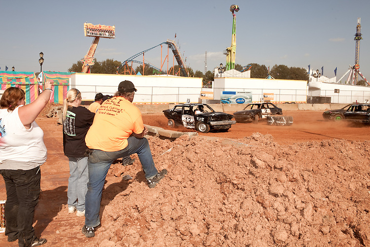 October 20, 2012. Raleigh, North Carolina.. Crews watch their cars in the finale of the 2012 North Carolina State Fair figure eight races. The races were judged in 2 qualifying heats of 8 laps and then the qualifiers competed in a 10 lap finale..