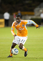 Lovel Palmer of the Houston Dynamo dribbles the ball during the regular season game between the Los Angeles Galaxy and the Houston Dynamo at Robertson Stadium in Houston, TX on April 10, 2010. Los Angeles 2, Houston 0.