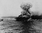 May 8, 1942 - A Japanese torpedo plane is hit during fighting in the Battle of the Coral Sea., 1942 - The USS Lexington burns following the Battle of the Coral Sea. The explosion may have been the gasoline system. Captain Sherman and others were still aboard.