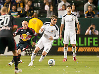 CARSON, CA – May 7, 2011: LA Galaxy midfielder David Beckham (23) moves the ball past New York Red Bull forward Luke Rodgers (9) during the match between LA Galaxy and New York Red Bull at the Home Depot Center, May 7, 2011 in Carson, California. Final score LA Galaxy 1, New York Red Bull 1.