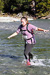 NELSON LAKES, NEW ZEALAND - APRIL 18:  Melissa Buschl crosses the Travers River during the 2015 Alpine Lodge Loop The Lake trail run at Lake Rotoiti on April 18 16, 2015 in Nelson, New Zealand. (Photo by Marc Palmano/Shuttersport Limited)