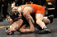 Tyler Shinn, right, pins Missouri's John Olanowski during a match at the 125-pound division.  Shinn won with a 7-1 decision over Olanowski.  Missouri (#11) tied the meet with Oklahoma State University (#2) 16-16.