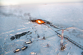 """Flaring"" at an unidentified drilling well in Novy Urengoi, Arctic Siberia, Russia. Photo by photographer Justin Jin."