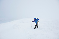 Female hiker near summit of Fan Brycheiniog in whiteout winter conditions, Black Mountain, Brecon Beacons naitonal park, Wales
