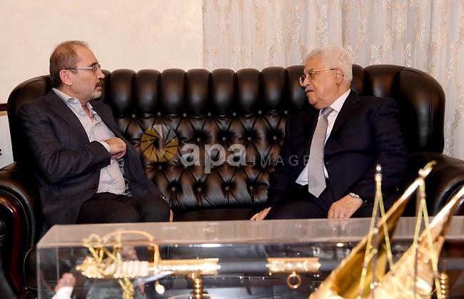 Palestinian President Mahmoud Abbas meets with Jordanian Foreign Minister Ayman Safadi, in Amman, Jordan, on May 05, 2017. Photo by Osama Falah