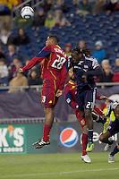 Real Salt Lake defender Chris Schuler (28) and New England Revolution midfielder Shalrie Joseph (21) battle for head ball. In a Major League Soccer (MLS) match, Real Salt Lake defeated the New England Revolution, 2-0, at Gillette Stadium on April 9, 2011.