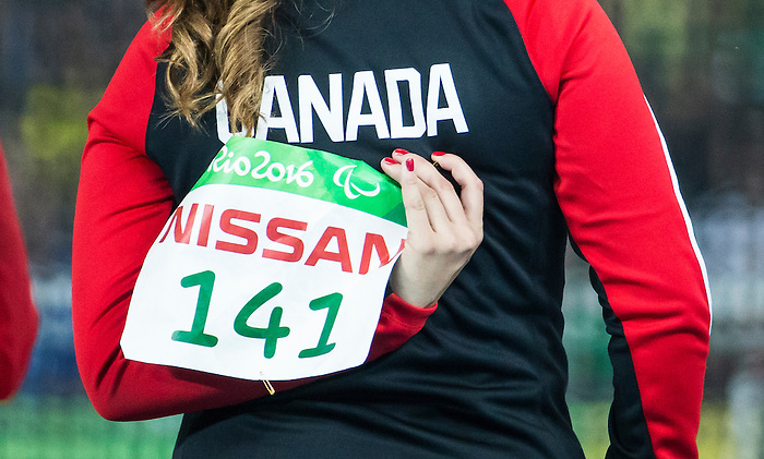 RIO DE JANEIRO - 17/9/2016:  Renee Foessel peel off her competition number following the women's F38 discus final at the Olympic Stadium during the Rio 2016 Paralympic Games. (Photo by Dave Holland/Canadian Paralympic Committee).