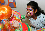 TORRINGTON, CT 01/01/09- 010209BZ05- Sandi Florkowski as &quot;Miss Pickles&quot; gets a laugh from Grace Ingoldsby, 11, of Torrington, as she gets a butterfly painted on her face during &quot;last night&quot; activities at the Torrington Armory Friday night.   The event, a celebration usually held on New Year's Eve, was rescheduled due to inclement weather.  <br /> Jamison C. Bazinet Republican-American