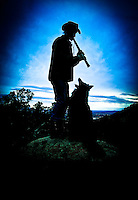 Alex (the dog) loves the flute - New Mexico. A man and his dog in the Southwest. (MR)<br />