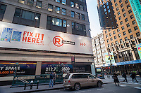 Advertising for RadioShack in New York on Thursday, January 15, 2015. The struggling electronics retailer is reported to be peppering to file for bankruptcy next month. The company has posted losses for the last 11 quarters and is running out of cash for its day-to-day operations. It employs 24,000 people. (© Richard B. Levine)