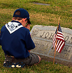 Photo by Phil Grout..Cub scout John Henry Saurusaitis of Lineboro pauses to pray.at the graveside of army veteran Tec5 Forrest L. Johnson .after planting an American flag at the grave.  Later, scout.Sarusaitis said he prayed, &quot;because it was the first flag today.and I just wanted to honor him.&quot;  Saurusaitis and his fellow scouts.of Pack 320 honored deceased veterans at the Old Lutheran Cemetery.in Manchester as well as the Immanuel Lutheran Church cemetery.as part of Memorial Day observance.