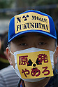 April 10, 2011 - A man wears a mask and baseball cap during an anti-nuclear protest at Koenji Chuo park in Koenji, Tokyo, Japan..According to the organisers 15,000 attended the protest more conservative estimates put the number at 5000. (Photo by B.Meyer-Kenny/2.0 images)