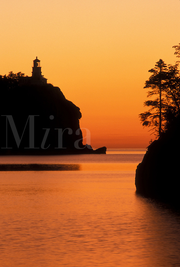 lighthouse, sunrise, Lake Superior, North Shore Drive, Two Harbors, MN, Minnesota, Split Rock Lighthouse situated on a high cliff on the north shore of Lake Superior at Split Rock Lighthouse State Park in Two Harbors at sunrise.