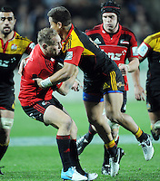 Crusaders Andy Ellis, left wrestles the ball from the Chiefs Tim Nanai-Williams in the Super 15 Rugby semi final match, Waikato Stadium, New Zealand, Friday, July 27, 2012. Credit:SNPA / Ross Setford