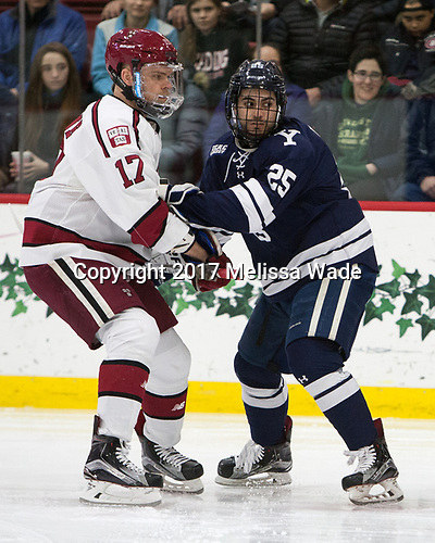 Sean Malone (Harvard - 17), Chris Izmirlian (Yale - 25) - The Harvard University Crimson defeated the Yale University Bulldogs 6-4 in the opening game of their ECAC quarterfinal series on Friday, March 10, 2017, at Bright-Landry Hockey Center in Boston, Massachusetts.