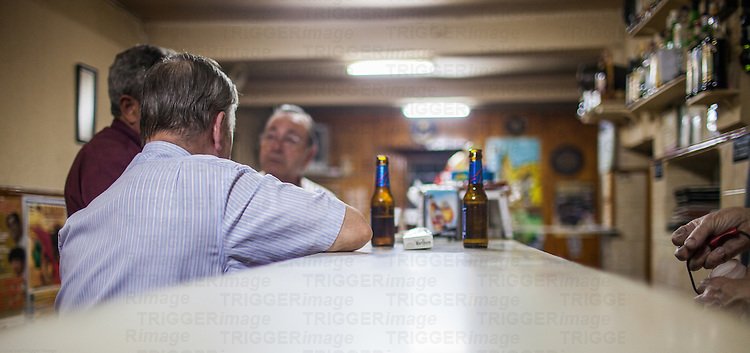 Customers in an old tavern, Burgo de Osma, Soria, Spain