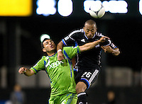 Victor Bernardez of Earthquakes battles for the ball in the air against Sammy Ochoa of Sounders during the game at Buck Shaw Stadium in Santa Clara, California on August 11th, 2012.   Earthquakes defeated Sounders, 2-1.