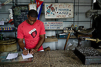 A Cuban shop assistant works in a state shop in Santiago de Cuba, Cuba, 1 August 2008. About 50 years after the national rebellion, led by Fidel Castro, and adopting the communist ideology shortly after the victory, the Caribbean island of Cuba is the only country in Americas having the communist political system. Although the Cuban state-controlled economy has never been developed enough to allow Cubans living in social conditions similar to the US or to Europe, mostly middle-age and older Cubans still support the Castro Brothers' regime and the idea of the Cuban Revolution. Since the 1990s Cuba struggles with chronic economic crisis and mainly young Cubans call for the economic changes.