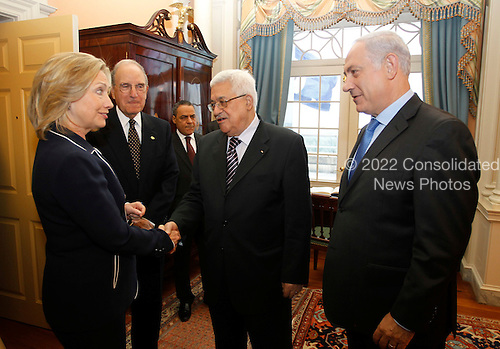 United States Secretary of State Hillary Clinton, left, welcomes Prime Minister Benjamin Netanyahu of Israel, right, President of the Palestinian Authority Mahmoud Abbas, 2nd right, and George Mitchell, U.S. Special Envoy for Middle East Peace, 2nd left, in the Monroe Room of the State Department moments before direct talks aimed at peace in the Middle East, in Washington, Thursday, September 2, 2010.     .Credit: Jason Reed / Pool via CNP