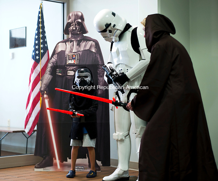 Middlebury, CT- 04 August 2016-080416CM05-  Nathan Nagrabski, 6, of Middlebury meets with Ben Beneacileo of Middlebury, who is dressed as a Storm Trooper and Middlebury Library Assistant Director/Children's Librarian, Jan LeDuc, right at the library in Middlebury on Thursday.  The event was part of the summer reading program, which ended with a showing of Star Wars: The Force Awakens.      Christopher Massa Republican-American