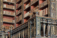 Bookshelves with Chinese motifs, lacquer and gilding by Manuel da Silva, in the Green Room of the Joanina Library, or Biblioteca Joanina, a Baroque library built 1717-28 by Gaspar Ferreira, part of the University of Coimbra General Library, in Coimbra, Portugal. The Casa da Livraria was built during the reign of King John V or Joao V, and consists of the Green Room, Red Room and Black Room, with 250,000 books dating from the 16th - 18th centuries. The library is part of the Faculty of Law and the University is housed in the buildings of the Royal Palace of Coimbra. The building is classified as a national monument and UNESCO World Heritage Site. Picture by Manuel Cohen