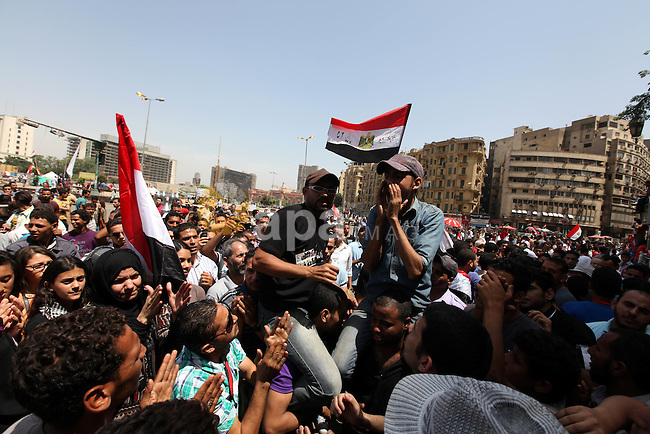 Egyptian protesters gather in Cairo's landmark Tahrir Square on June 3, 2012. Hundreds of demonstrators are occupying Tahrir Square after a court sentenced ousted president Hosni Mubarak and his interior minister Habib al-Adly to life in prison but acquitted six security chiefs in the deaths of protesters last year. Photo by Majdi Fathi