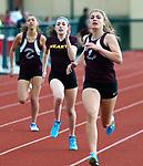 TORRINGTON, CT-051017JS05- Torrington's Brianna Grubaugh held off Sacred Heart's Brianna Cyr to win the 400m run during their meet with Wilby Wednesday at Torrington High School. <br /> Jim Shannon Republican-American