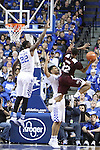 Forward Alex Poythress and Guard Isaiah Briscoe of the Kentucky Wildcats attempt to block Xavian Stapleton's shot  during the game against the Mississippi State Bulldogs at Rupp Arena on January 20, 2015 in Lexington, Kentucky. Photo by Taylor Pence