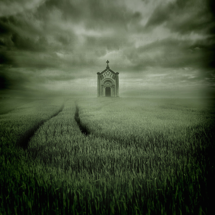 Conceptual image of a field with crops with a small chapel under a stormy sky