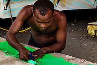 A Brazilian man works on the Carnival allegorical float in the Samba school workshop in Rio de Janeiro, Brazil, 19 February 2004.