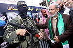 A Palestinian Hamas leader, Mahmoud al-Zahar speaks with a militant during a rally marking the 2nd anniversary of Israeli war on Gaza Strip, in Gaza City on January 1, 2011. Photo by Mohammed Asad