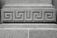 Geometric design on the facade of a stone building in Vancouver, BC, Canada