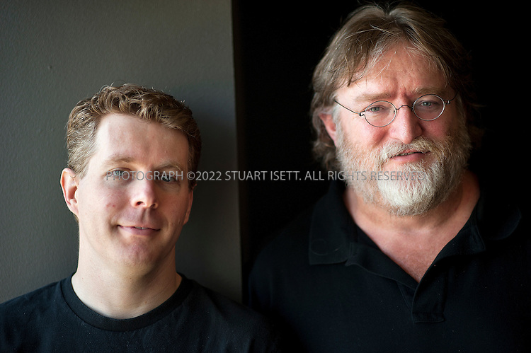 8/2/2012--Bellevue, WA, USA..Gabe Newell (right) is the co-founder and managing director of the video game development and online distribution company Valve, based in Bellevue, WA. Here he poses with employee Robin Walker...The office is set up as a 'boss less' office that is fluid and non-hierarchical. Desks come with wheels so that they can be easily moved and reconfigured to create new work spaces for new projects. The desks can also be raised or lowered for comfort or to create a standing work space...©2012 Stuart Isett. All rights reserved.