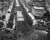 Parisians line the Champ Elysees to cheer the massed infantry units of the American army as they march in review towards the Arc de Triomphe, celebrating the liberation of the capital of France from Nazi occupation.  August 29, 1944.  Parker.  (Army)<br /> NARA FILE #:  111-SC-193997<br /> WAR &amp; CONFLICT BOOK #:  1060