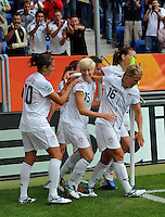 Megan Rapinoe (C) celebrates with teammates during the FIFA Women's World Cup at the FIFA Stadium in Sinsheim, Germany on July 2nd, 2011.