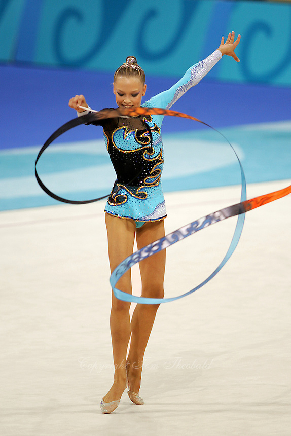 Dominika Cervenkova of Czech Republic...waves circles with ribbon during qualifications round at Athens Olympic Games on August 27, 2004 at Athens, Greece. (Photo by Tom Theobald)