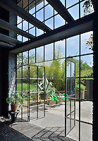 The view through a full height paned window with a pair of double doors, which lead to a terrace beyond.