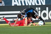 Nick Garcia gets tangled underneath Joey Gjersten (17). Toronto FC defeated the San Jose Earthquakes 3-1 at Buck Shaw Stadium in Santa Clara, California on May 29th, 2010.