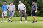 SOUTHBURY CT. 08 June 2015-060815SV01-From left, Joe Perugini of Watertown, Tom Tuller of Tolland, Bob Davis of Watertown, and John Tuller of Port St. Lucie, FL. watch a putt just miss the hole while playing in the Fore the River golf tournament at the Heritage Village Country Club in Southbury Monday. The Housatonic Valley Association hosted the event. The proceeds will support the association's projects to protect rivers and drinking water, and restore natural areas through the 83 towns in the Housatonic River watershed. <br /> Steven Valenti Republican-American