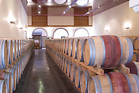 Oak barrel aging and fermentation cellar. Chateau Le Fournas Bernadotte, Medoc, Bordeaux, France