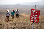 Deminers with the Halo Trust sweep the Chartar 5B minefield for anti-tank mines in the Martuni region of Nagorno-Karabakh.