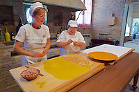 Castelfranco Emilia, Festa di San Nicola - Sagra del Tortellino (Tortellini Festival).<br /> Preparing tortellini in a historic kitchen at Panzano Castle.