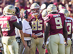 Florida State head coach Jimbo Fisher talks with his team during a replay time out in the first half of an NCAA college football game against Wake Forest in Tallahassee, Fla., Saturday, Oct. 15, 2016. (AP Photo/Mark Wallheiser)