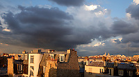PARIS, FRANCE  - MAY 15 : A general view of rooftops on 15 May, 2008, in Montmartre, in the 18th arrondissement of Paris, France. Beyond the rooftops of the mainly 19th century cityscape may be seen the dome of Sacre Coeur, beneath a stormy sky on a spring evening. (Photo by Manuel Cohen)