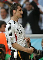 JUNE 9, 2006: Munich, Germany: German forward (11) Miroslav Klose celebrates his goal during the World Cup Finals in Munich, Germany. Germany defeated Costa Rica, 4-2.