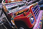 Colorful busses provide public transportation in Panama City. Each bus is painted differently and reflects the owners tastes. © Michael Brands. 970-379-1885.