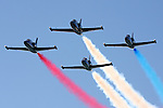 Four L-39 Albatross of the Patriot's Jet Demonstration Team in flight.