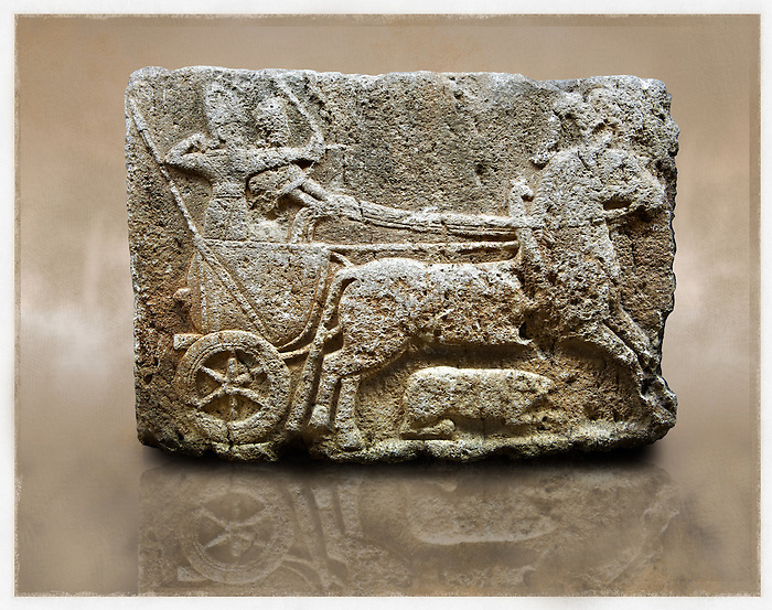 Picture & image of a Neo-Hittite orthostat with a chariot Releif sculpture from Karkamis,, Turkey. Museum of Anatolian Civilisations, Ankara. The Cahiot is pulled by horses with plumed headresses. One man os about to shoot an arrow from his bow, the other man is driving the cahriot. Below the horse is a animal cowering. 4