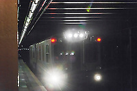 The bright lights of a NYCTA subway track inspection train are seen as the train passes through the West 23rd Street station on Tuesday, March 22, 2016. (© Richard B. Levine)