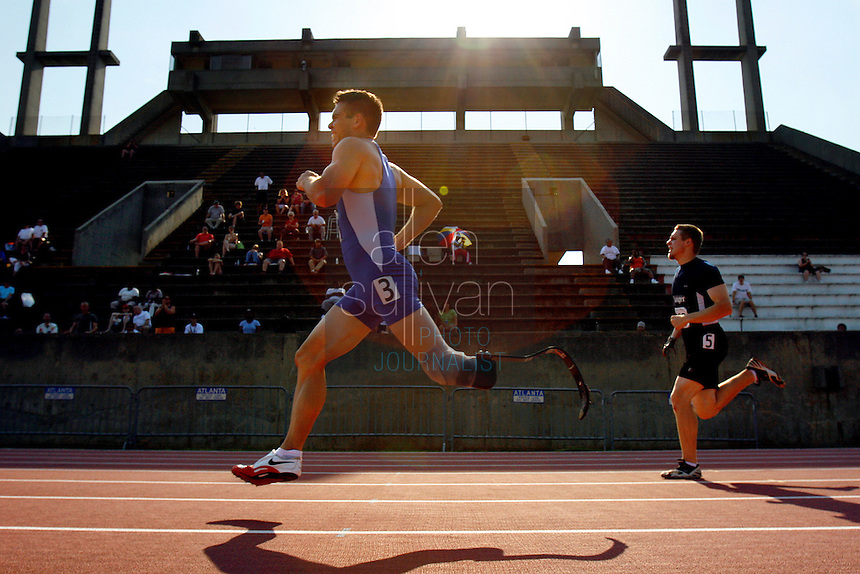 Danny Andrews (center), of Tucson, Ariz., makes the final stretch to a win in a combined-class 400-meter run during the U.S. Paralympics Track and Field National Championships at Lakewood Stadium in Atlanta on Saturday, July 1, 2006. The Paralympics event is the qualifier to gain entry on the U.S. Team for the International Paralympic Committee Athletics Championships in Switzerland.